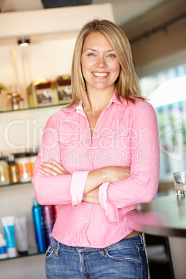 Woman working in hairdressing salon