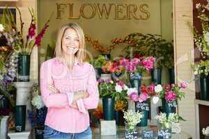 Woman standing outside florist