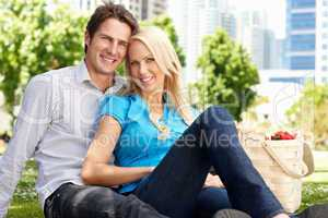 Couple in city park with picnic