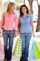 Women carrying shopping