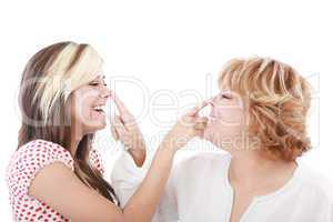 girl and mother profiles, playful woman with nose daughter play