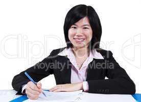 Asian woman working.