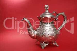 Elegant retro kettle on red background