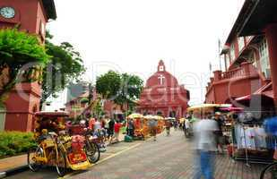 Tourist activity in front Christ Church Malacca.