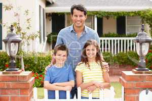 Father and children outside home