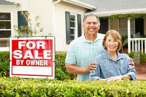 Senior Hispanic couple selling house