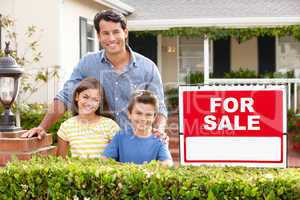 Father and children outside home for sale