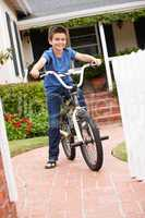 Boy in garden with bike