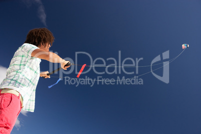 Teenage boy flying a kite