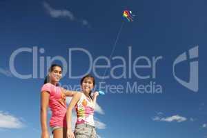 Teenage girls flying a kite