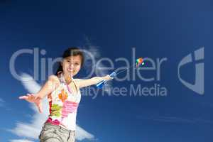 Teenage girl flying a kite