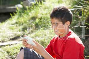 Teenage boy playing with computer game