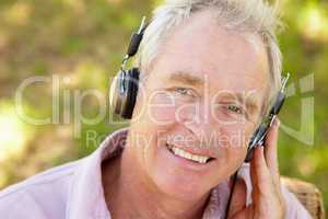 Senior man with headphone