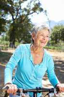 Senior woman on country bike ride
