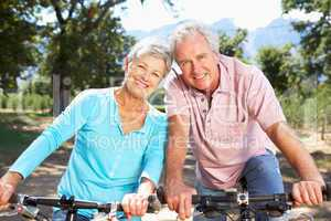 Senior couple on country bike ride