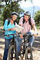 Senior couple with map on country bike ride
