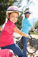 Little girl on country bike ride with grandma