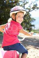 Little girl on country bike ride