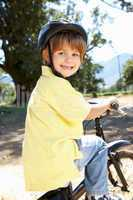 Little boy on country bike ride