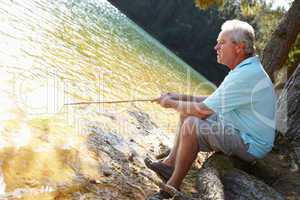 Senior man fishing at lake