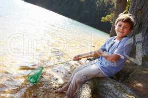 Happy boy fishing at lake