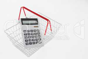 supermarket basket and calculator