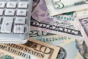 Detail dollar bills and calculator