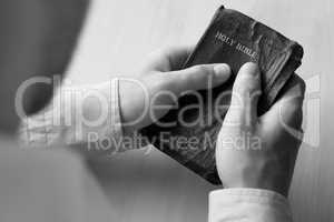 Young man holding bible