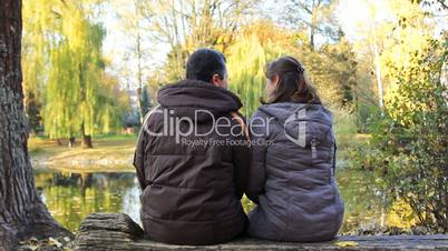 Couple Sits In Park
