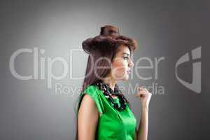 Cute woman posing in hair style hat - green dress