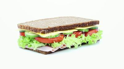 sandwich rotating on white