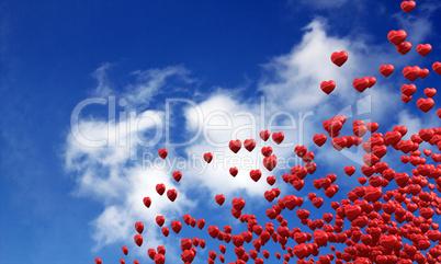 Fliegende rote Herzen im Sommer