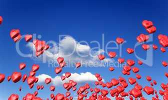 Fliegende rote Herzen im Frühling