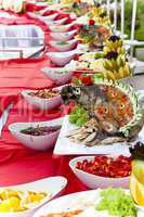 Celebratory food: stuffed fish on served table