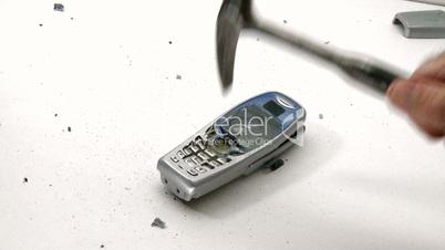 Businessman destroy mobile phone with hammer