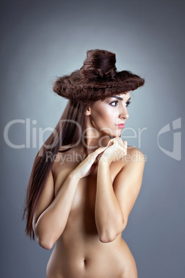 Bare woman with hair style close breast look aside