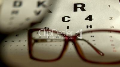 Eye test and eyeglasses, red