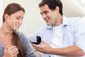 Happy man proposing marriage to his girlfriend