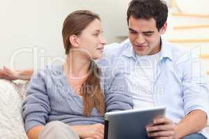 Engaged couple using a tablet computer