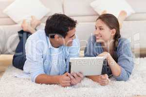 Cute couple using a tablet computer