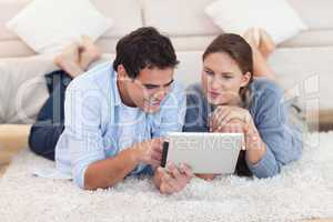 Radiant couple using a tablet computer