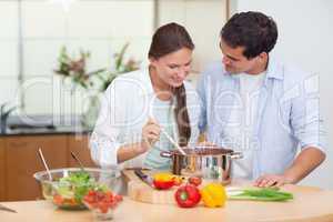Couple preparing a sauce