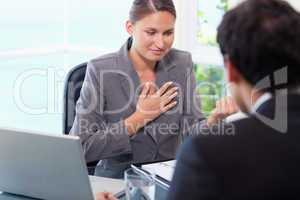 Businesswoman talking to customer