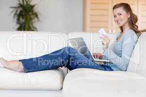 Woman on sofa placing an order online