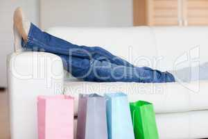 Woman relaxing on the sofa after shopping tour