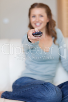 Remote control being used by young woman