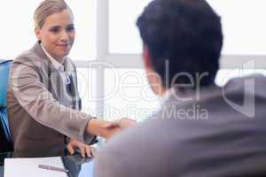 Businesswoman receiving a customer