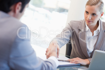 Serious manager interviewing a male applicant