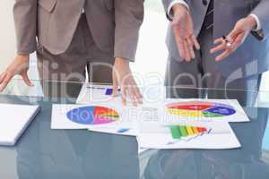 Hands of business people working on statistics