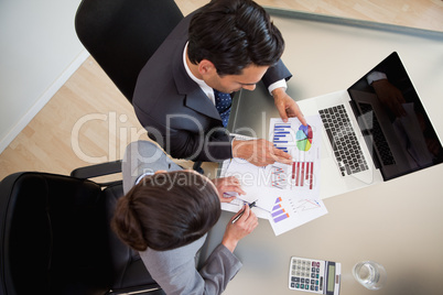 Sales persons studying statistics